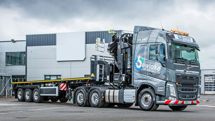 County Antrim based, Bewlake Lift and Haul Ltd is a new-start business that has selected a crane-equipped Volvo FH tractor unit, coupled to an SDC trailer, to launch its operations.)