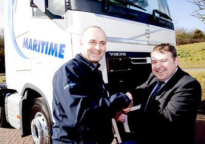 Maritime Transport driver Derek Drummond (left) was presented with the keys to his new Volvo FH by the company's Liverpool Area Manager Brian McWhirter.)