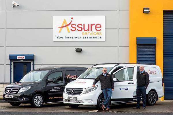 Assure Services Managing Director Damien Martin, left, and Sales Manager Adrian Maguire, with their smart Mercedes-Benz vans)